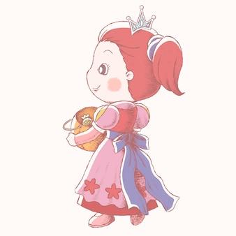 Śliczna mała księżniczka trzyma dyniowe wiadro i cieszy się cukierek