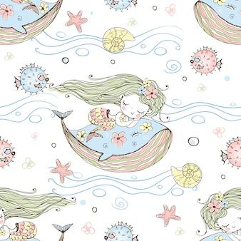 Śliczna mała syrenka śpi na wielorybie.