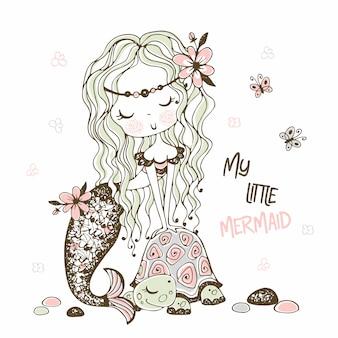 Śliczna mała syrenka z żółwiem. doodle styl.