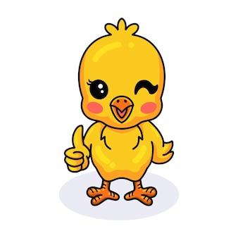 Śliczna mała żółta laska kreskówka daje kciuk w górę