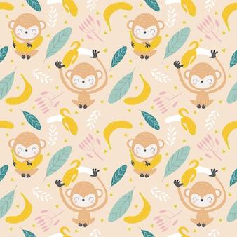 Śliczna małpa i bananowy bezszwowy wzór / tło