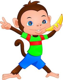 Śliczna małpa kreskówka trzyma banana