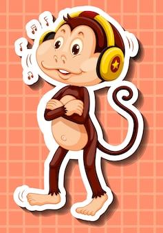 Śliczna małpa słucha muzyka na słuchawki