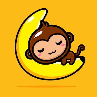 Śliczna małpa śpi na księżycu w kształcie banana