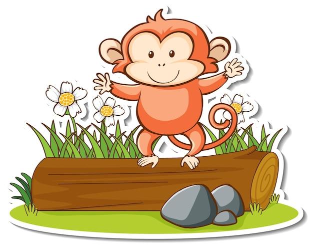 Śliczna małpa stojąca na naklejce z kłody