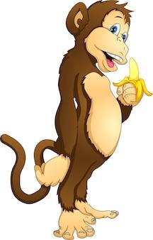 Śliczna małpa trzyma banana