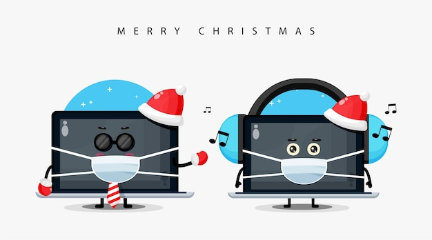 Śliczna maskotka laptopa w świątecznym kapeluszu i masce medycznej
