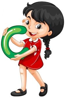 Śliczna młoda dziewczyna trzyma angielskie litery