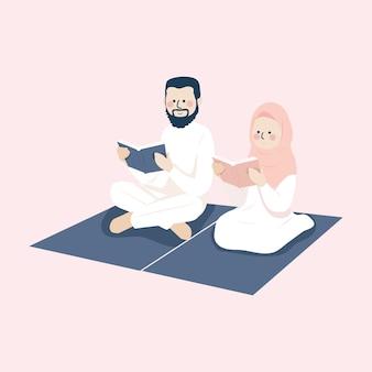 Śliczna muzułmańska para czytająca koran razem na macie modlitewnej