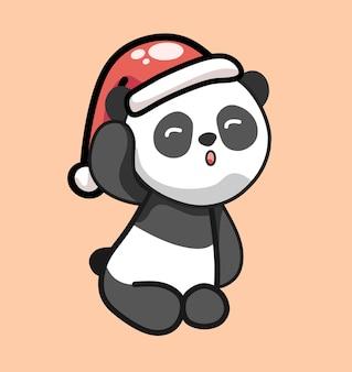 Śliczna panda siedząca w czerwonym świątecznym kapeluszu mikołajkowym