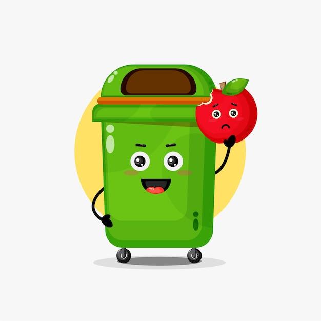 Śliczna postać kosza na śmieci niosąca czerwone jabłko