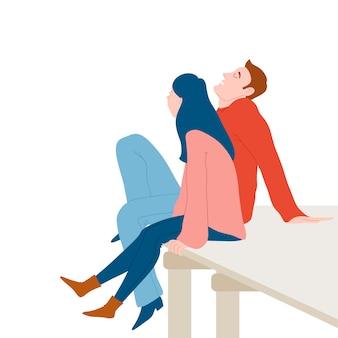 Śliczna romantyczna para siedzi na drewnianym doku, relaksuje wpólnie