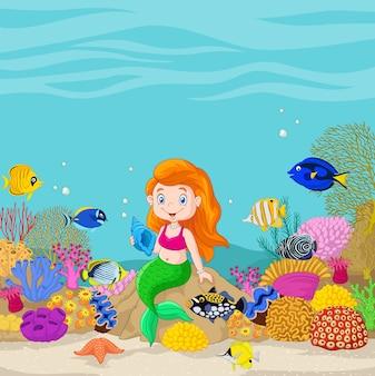 Śliczna syrenka przedstawia w podwodnym tle