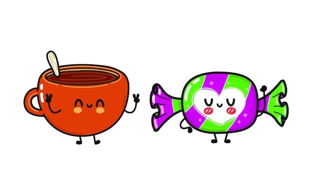 Śliczna zabawna szczęśliwa filiżanka kawy i cukierków