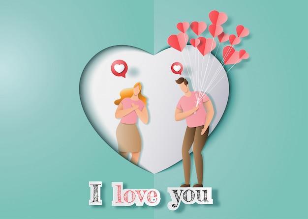 Śliczna zakochana para, mężczyzna posiadający wiele serc balonów, które ma zamiar dać dziewczynie.