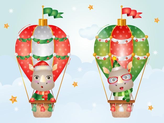 Śliczne bożonarodzeniowe postacie nosorożców na balonie z czapką mikołaja, kurtką i szalikiem