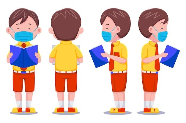 Śliczne dzieci chłopiec postać studenta czytanie książki noszenie maski.