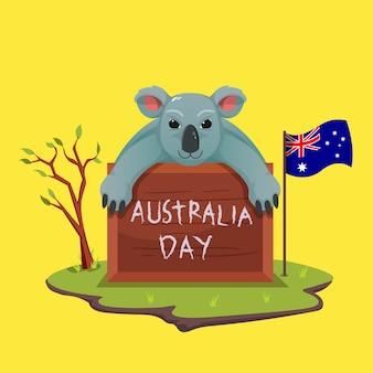 Śliczne koale świętują dzień australii z tablicami kredkowymi i pismem