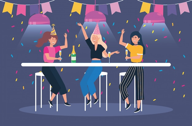 Śliczne kobiety z szampanem i przyjęciem