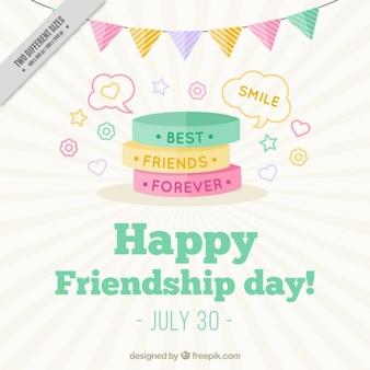 Śliczne kolorowe bransoletki tła dzień przyjaźni