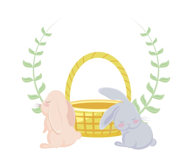 Śliczne króliki z wiklinowym koszykiem i koroną z liści