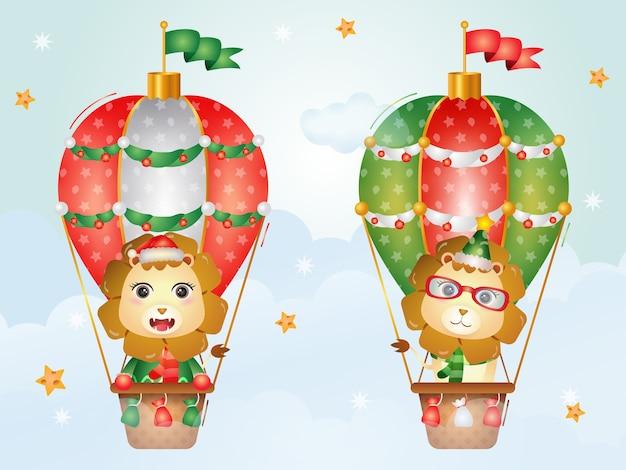 Śliczne lwy świąteczne postacie na balonie z czapką mikołaja, kurtką i szalikiem
