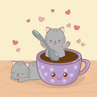 Śliczne małe koty z kawaii z filiżanką kawy