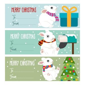 Śliczne płaskie etykiety świąteczne lub kolekcja tagów dla presetów z królikami. wektor