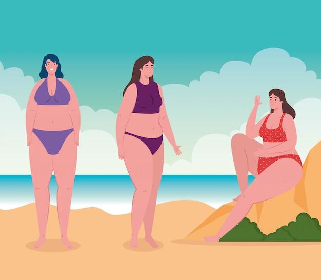 Śliczne pulchne kobiety w kostiumie kąpielowym na plaży, grupa przyjaciół na plaży, sezon wakacji letnich