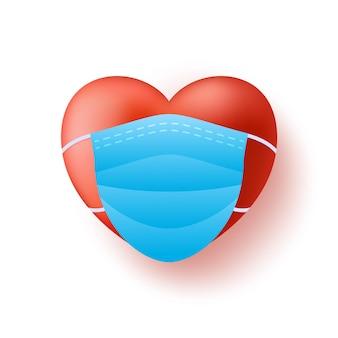Śliczne realistyczne czerwone serce w niebieskiej masce medycznej