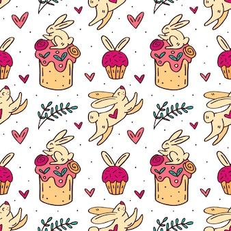Śliczne śmieszne króliki wielkanocne, ciasta wielkanocne, babeczki, zioła i serca ładny doodle ręcznie rysowane wzór