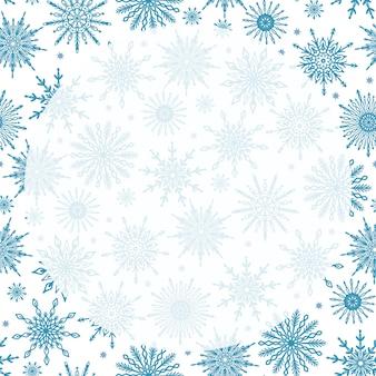 Śliczne świąteczne tło wzór sezonu zimowego z różnymi płatkami śniegu okrągłą przezroczystą przestrzenią kopii