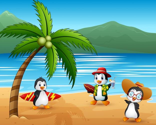Śliczni kreskówka pingwiny w wakacje letni