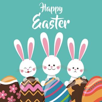 Śliczni króliki z jajecznym ornamentem szczęśliwy easter