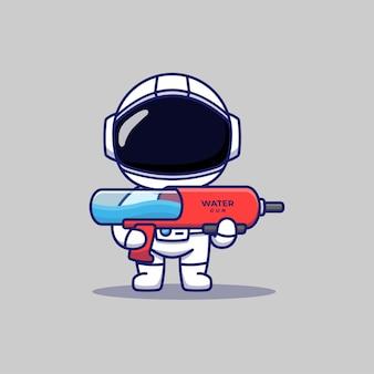 Śliczny astronauta niosący pistolet na wodę