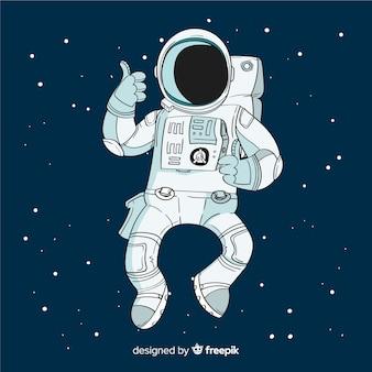 Śliczny astronauta rysujący ręka charakter