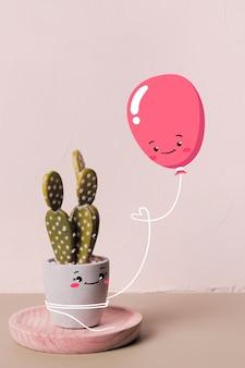 Śliczny balon trzyma szczęśliwego kaktusa