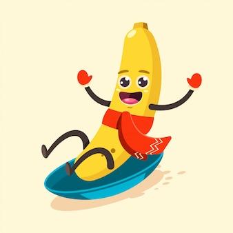 Śliczny bananowy dzieciak w szalika postać z kreskówki saniu na śnieżnej ilustraci odizolowywającej dalej.