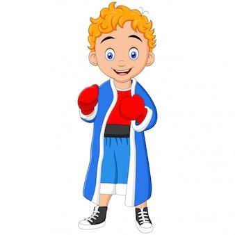 Śliczny bokser chłopiec w sportowym mundurze