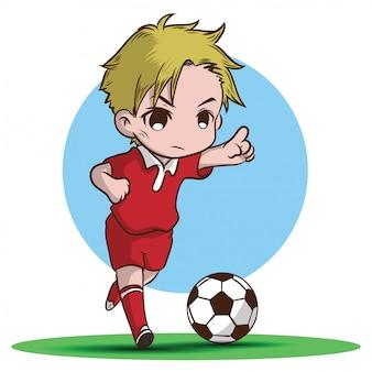 Śliczny chłopiec bawić się futbolową postać z kreskówki