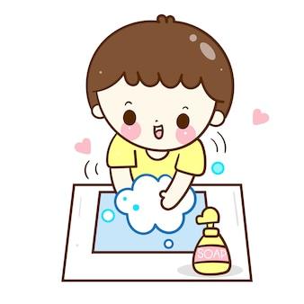 Śliczny chłopiec domycia ręk dzieciak z mydlaną kreskówką