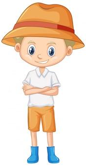 Śliczny chłopiec jest ubranym kapelusz i buty