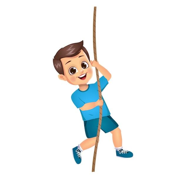 Śliczny chłopiec wspina się po linie