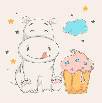Śliczny hipopotam siedzi blisko dużego torta