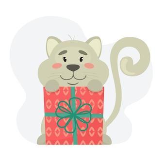 Śliczny i szczęśliwy kotek z prezentem.