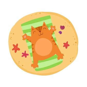 Śliczny imbirowy kot kłama na plaży. urocza kotka odpoczywa. czas na odpoczynek. jasne lato