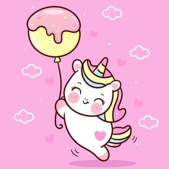 Śliczny jednorożec kreskówka holiding cupcake balon kawaii zwierzę