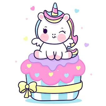 Śliczny jednorożec kreskówka siedzieć na urodzinowym ciastku kawaii zwierzęciu