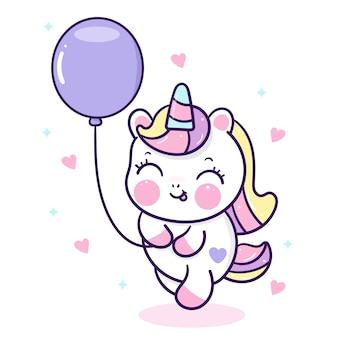 Śliczny jednorożec kreskówka z balonem