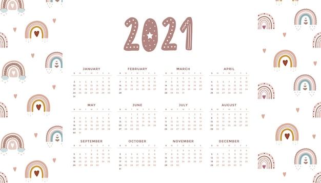 Śliczny kalendarz 2021 z tęczą boho dla dzieci. ilustracja kreskówka. szablon w stylu skandynawskim.